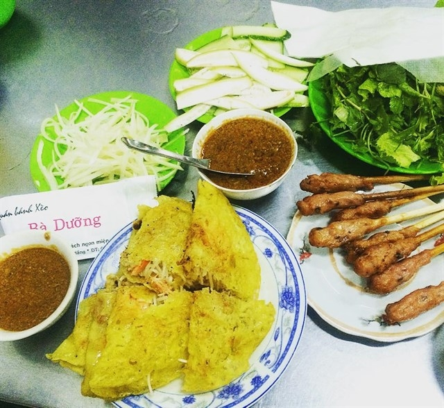 Ba Duong pancakes served with raw vegetables, pickles, dipping sauce and spring rolls