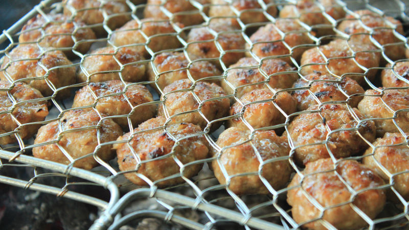 Grilled rolls are cooked on a grill