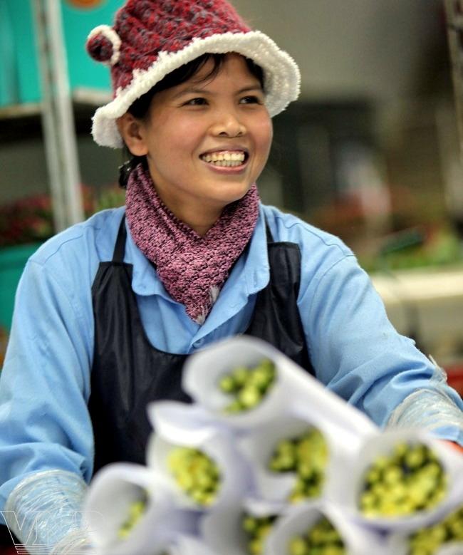 Chị bán hoa (ảnh minh họa)