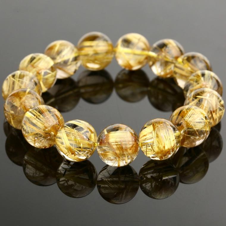 trang sức làm từ thạch anh tóc vàng mang lại may mắn, sức khỏe và sự sáng suốt  cho người mệnh thổ
