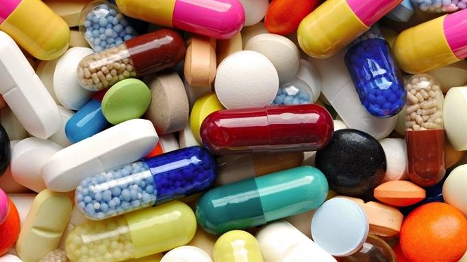 Dùng thuốc điều trị đau lưng