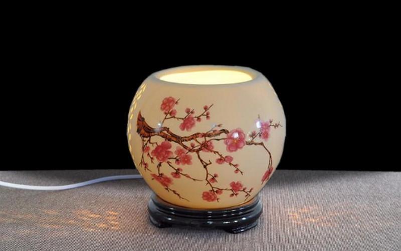 Đèn xông tinh dầu hoa đào Minh Quang