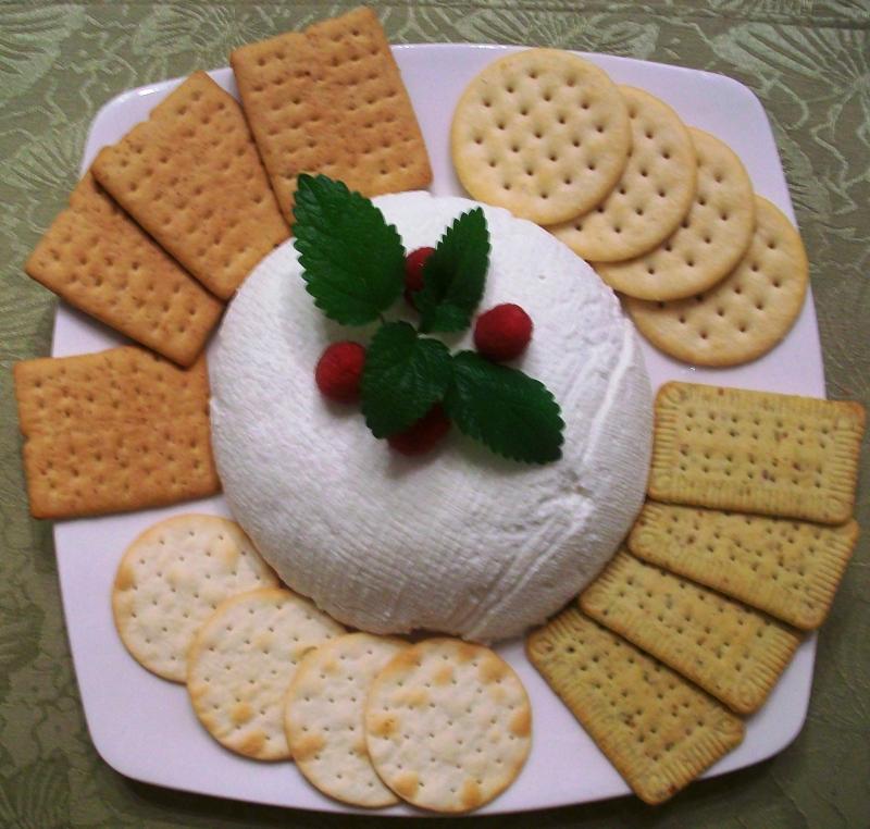Ricotta( phomat) mềm mịn có màu trắng, vị hơi ngọt và rất ít béo.