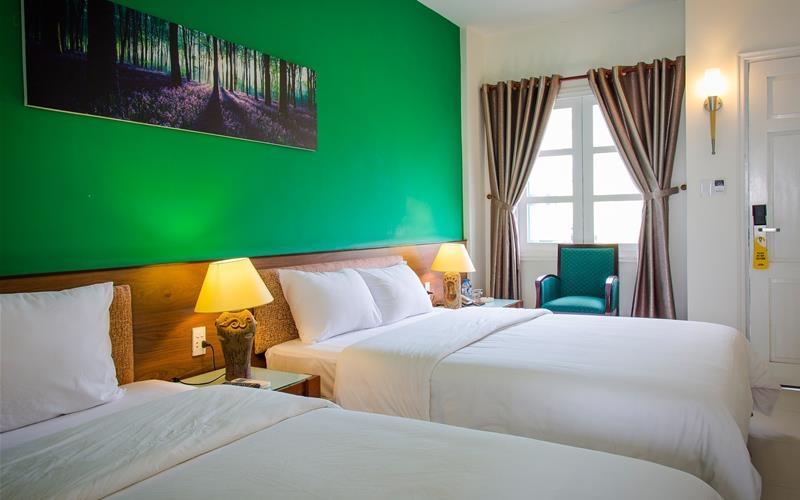 Phòng ngủ tại Sài Gòn Phong Nha Hotel