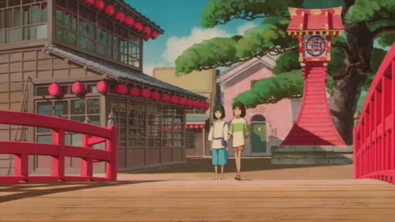 Haku nắm tay Chihiro qua cầu.