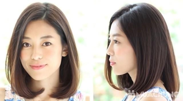 Kiểu tóc ngắn bob uốn cụp ngang vai sẽ giúp gương mặt của bạn thanh thoát hơn